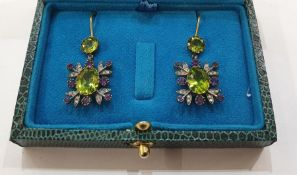 Pair of yellow and white metal, peridot, amethyst and diamond drop earrings, each with circular