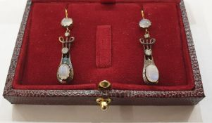 Pair of yellow and white metal, diamond and moonstone drop earrings, each set with two cabochon