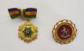 9ct gold and enamel Invicta broochwith scallop border, red enamel and horse centre and another 1993