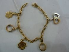 Cartier 18K charm bracelet hung with five detachable charms, 32.4g