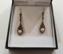 Pair of yellow metal, ruby and diamond drop earrings, each with small rubies and diamonds above