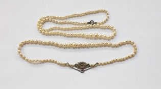 String of graduated cultured pearls on silver and marcasite set clasp and another string of