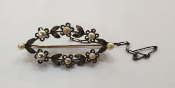 Yellow and white metal, pearl and diamond brooch, pierced elliptical, floral and foliate set with