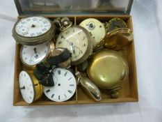 Stainless steel cigarette box containing pocket watches and parts
