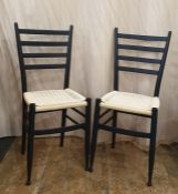 Set of four black matt occasional chairs with ladder backs and woven string work seats