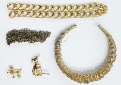 Gilt metal chokerof twisted wire design, animal brooches, clip earrings, beadsand other