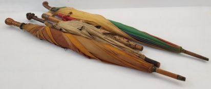 1920's/30's cotton parasolwith multicoloured bakelite top on wooden handle, a fabric parasolwith