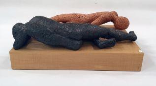 Marlene Badger terracotta sculpture - two reclining gentlemen on wooden base, 42cm long