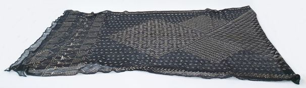 Early 20th century Assuit shawlwith silver metal design on black mesh, 71cm wide x 240cm long