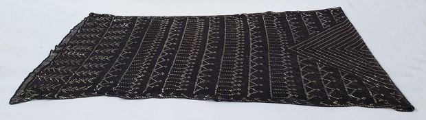 Early 20th century black Assuit shawlwith silver-coloured metal, geometric and diamond design on