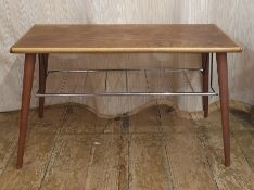 20th century rectangular coffee table with chrome slung paper rack under on circular section