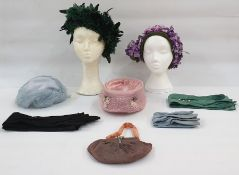 Mitzi Lorenz model hat, labelled, in shades of purple with flowers, on a green net and satin base, a