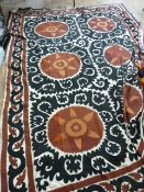Indian Susani black and rust-coloured wool embroidered onto a cream linen ground, some fraying and