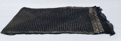 Early 20th century black Assuit shawl on a black mesh ground with hammered gold-coloured