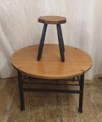 Mid-20th century teak and black metal circular occasional table,68.5cm diameter together with an
