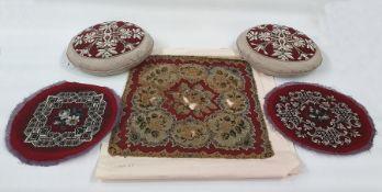 Pair of Berlin woolwork panels on circular grey silk cushions, pair ofVictorian Berlin woolwork