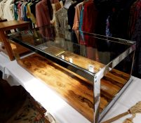 1970's Merrow Associates glass, chrome and rosewood two-tier rectangular coffee table upon