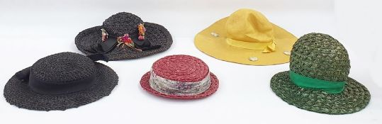 Various vintage hats including a black straw decorated with faux-flowers, a large coolie hat with