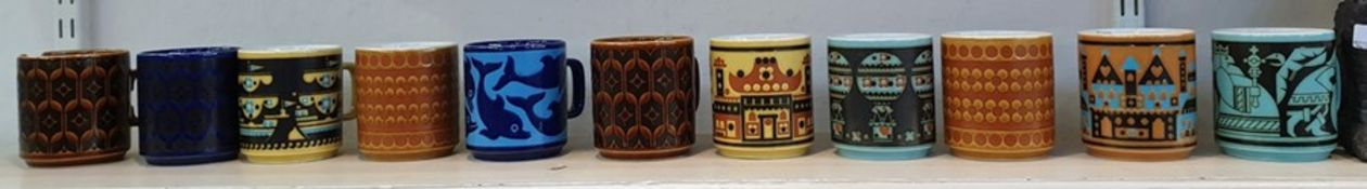 Quantity of 1970's Hornsea mugs including birthday mug, air balloon ship and castle decorated, one
