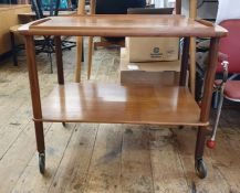 Mid-20th century teak two tier tea trolley, the half gallery tray top above uniting the under-tier