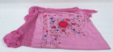 Large pink silk piano shawl, heavily embroidered and deep pink fringe