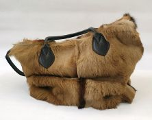 Travel bag made out of cow hide