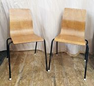 Two plywood shaped dining chairson four metal legs, the plywood sheet bent to form the seat and