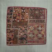 Indian embroidered and mica panel backed onto a silk covered board, 30cm x 30cm approx