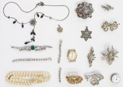 Quantity of marcasite set brooches, silver bar brooch, diamante and other items in leather-covered