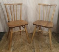 Set of four mid-20th century light elm Ercol seated and beech stick-back and framed dining chairs