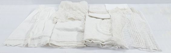 Net christening gownembroidered with flowers with under petticoat, assorted linenand cotton