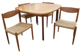 Mid-20th century G-Plan teak and stained wood extending dining table with rounded rectangular top on