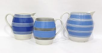 Three variously sized blue-banded jugs, ovoid (3)