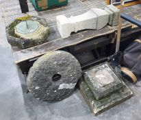 Stone weathered sundial, the metal sundial set centre, on stone plinth and square stepped base