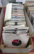 Case of 45rpm singles to include examples by The Bee Gees, The Buzzcocks, Bob Marley, Boney M, The