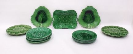 Quantity of green glazed leaf moulded majolica pla
