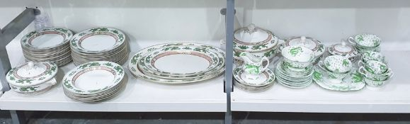 Large quantity of Booths pottery dinner service with green and gilt decoration to the borders, to