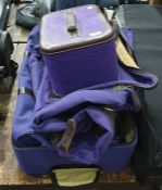 Purple canvas and leather travelling vanity case marked T. Anthony Limited with matching suit