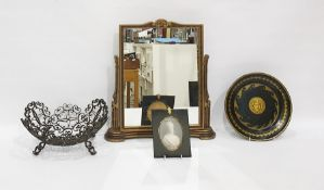 Gilt and black metal shallow dishdecorated with Medusa head, a gilt and stained wood easel