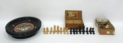 Set of stained wood chess pieces, an ebonised wood roulette wheeland a quantity of counters