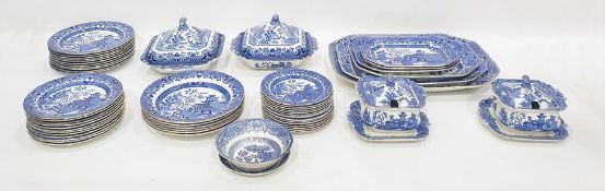 Large quantity of underglaze blue 'Willow' pattern decorated tableware to include four graduated