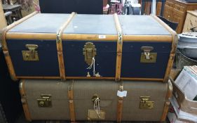 Two canvas and wood-bound school trunks, both with keys (2)