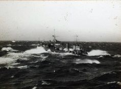 Black and white photograph of a battleship in stor