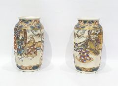 Pair of Japanese pottery vases, each shouldered and panelled, decorated with scenes of warriors