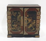 Japanese lacquered and painted table-top cabinet with three drawers enclosed by pair panel doors,