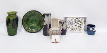 Four various studio pottery vases, a Poole porcelain miniature stepped vaseof Art Nouveau style,