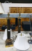 Pair of brass and lacquer finished table lamps in the form of ionic columns on stepped square bases,