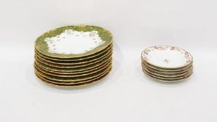 Set of three Limoges porcelain dinner plates by J Pouya with green and gilt brocade borders,