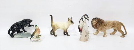 Beswick modelblack pantheron rock, 14cm high, a Melbaware model lion, a Karl Ens porcelain model