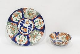 Large Japanese Imari porcelain charger with typical decoration, in fan-pattern reserves, in iron-